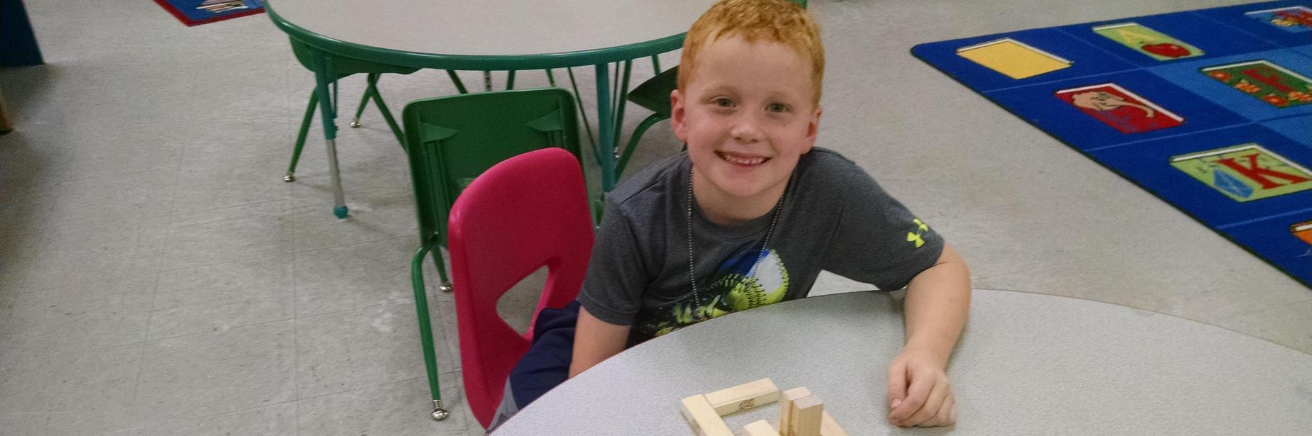 Boy with jenga cubes
