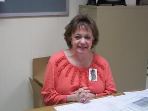 A staff member wears orange for