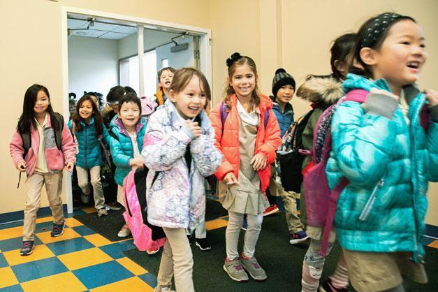 HudsonWay Immersion School students arrive at school for the day