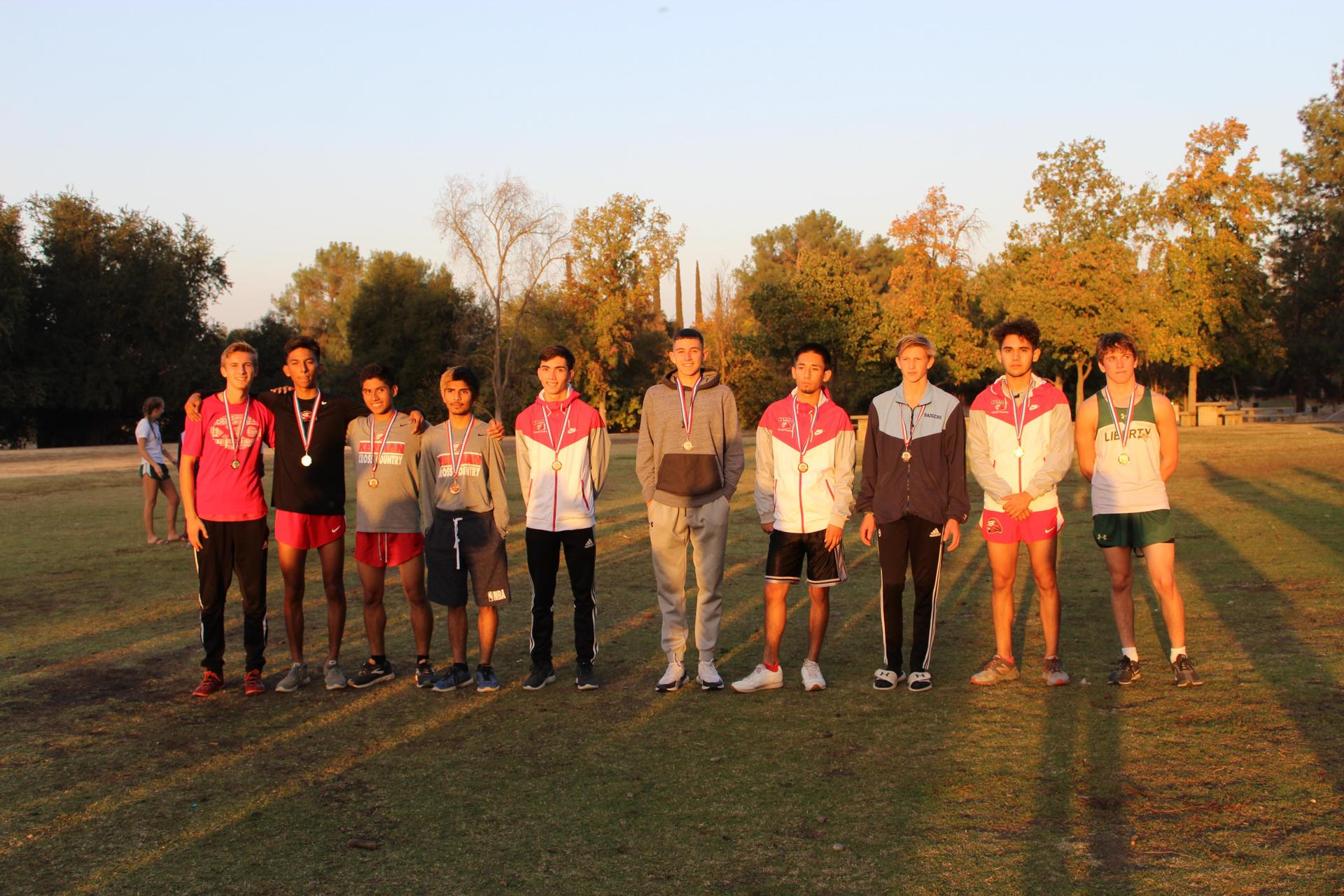 Varsity Boys medalists pose.