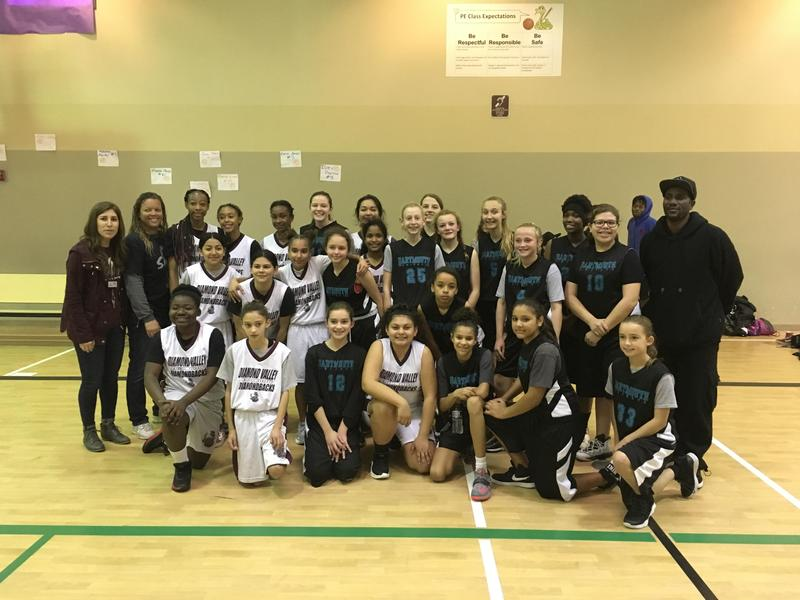 Teams from Dartmouth and Diamond Valley share a moment after the Diamond Valley League Championship game.