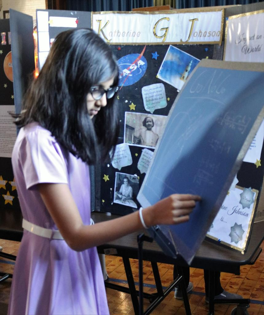 "Photo of Wilson 5th grader as Katherine Johnson at annual ""Wax Museum"" event."
