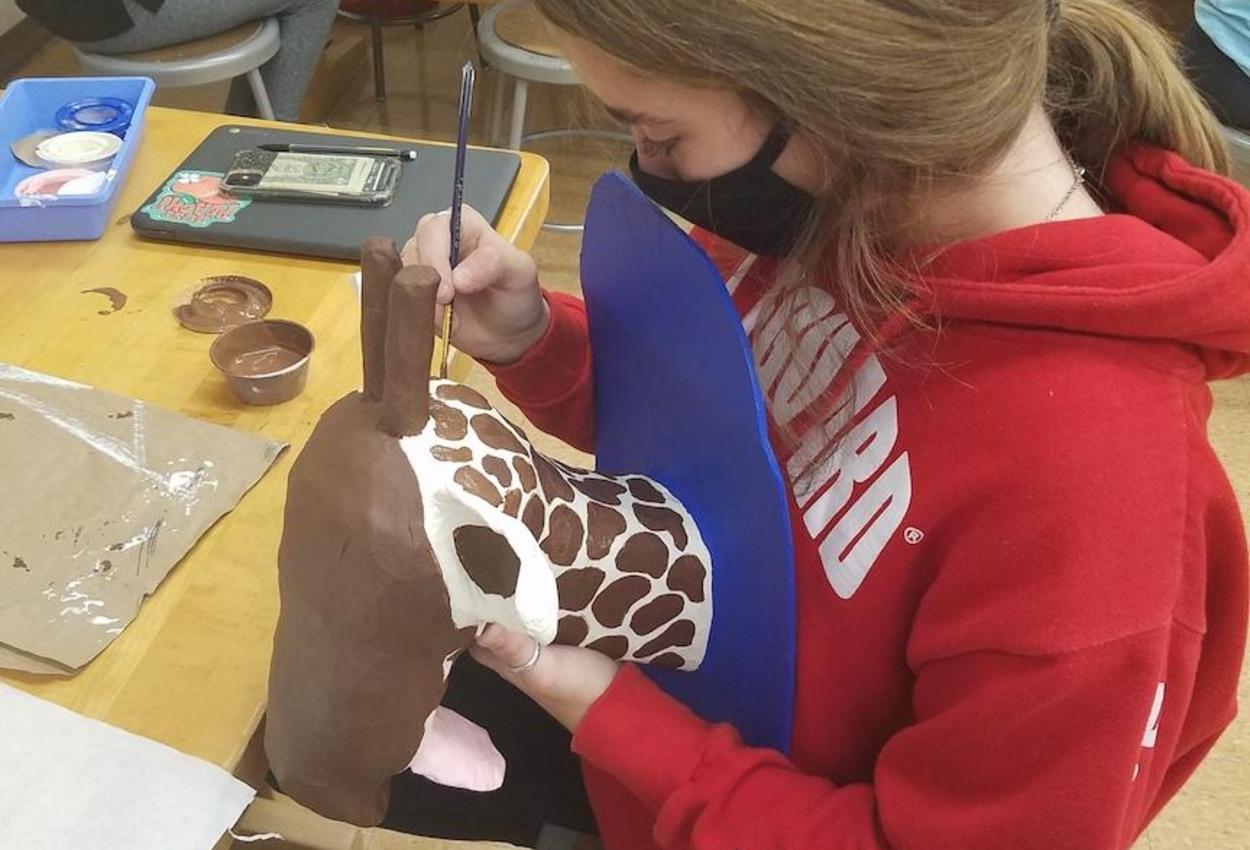 student making sculpture