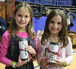 Photo of two McKinley students showing crafts made during special Handmade Holidays event.