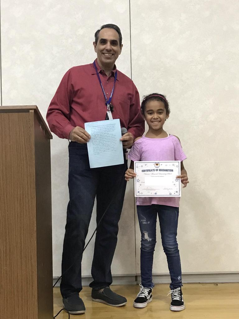 v. paniagua with vp calvo holding her winning essay