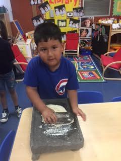 Student making torilla.