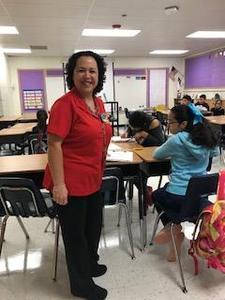 Mrs. Garcia at the door enterance of her class.