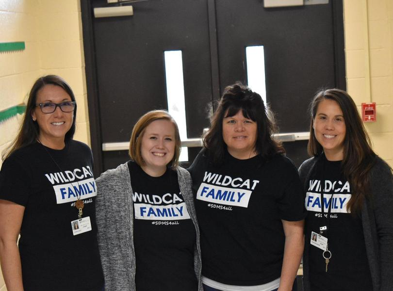 6th Grade Teachers posing in the hallway