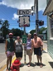 Ms. Butler with her brother Brad and parents Bob and Becky at the Highway 1 'Mile 0' marker in Key West, Florida in July 2019