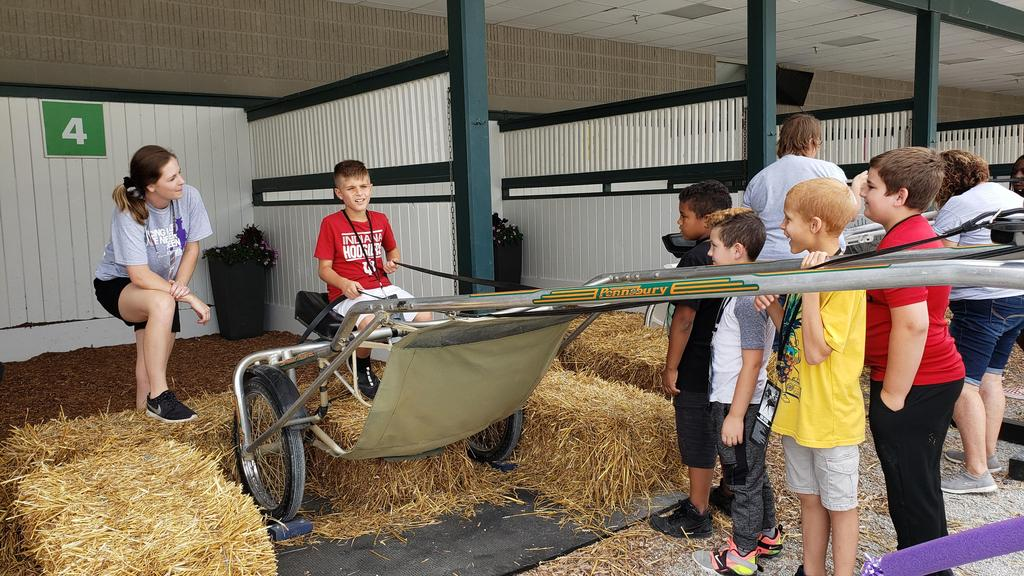 student on jockey cart at hoosier park