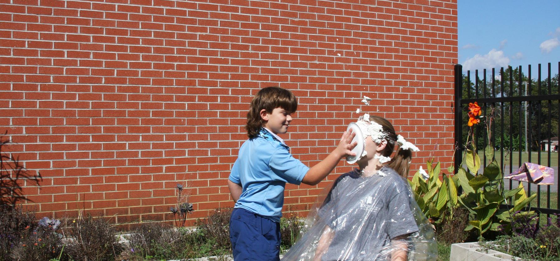 Ms.Martin gets a pie in the face for iReady lesson passed!