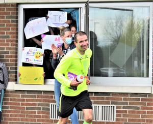 Page Principal Mr. Bruno receives some water and snacks from students after completing a 13-mile run.