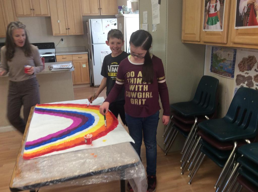 children working on art