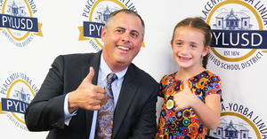 Dr. Greg Plutko with student.