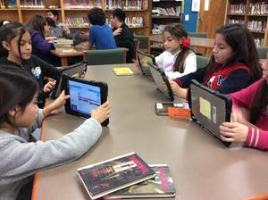students coding on iPad.