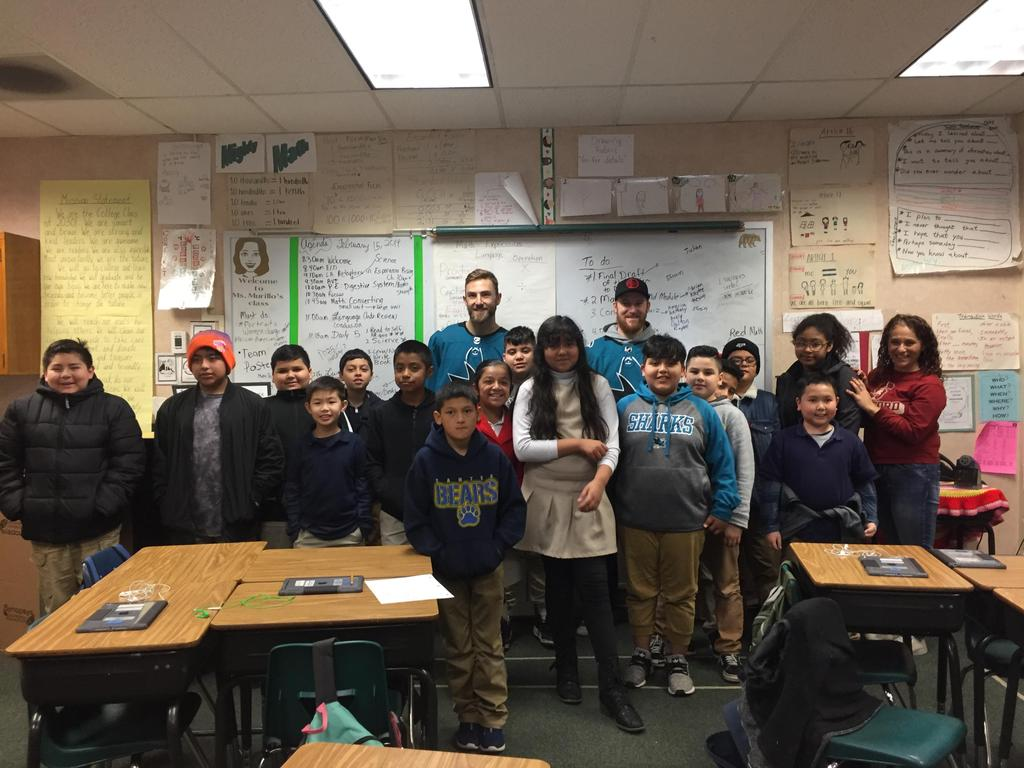 sharks players pose for a picture with Ms. Murillo and her class