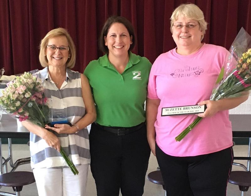 Pair Education Center Support Staff of the Year Donna Stone, left, and Teacher of the Year  Suzette Brunson, right, with Principal CR Hall. The district's schools announced their winners at the end of the school year.