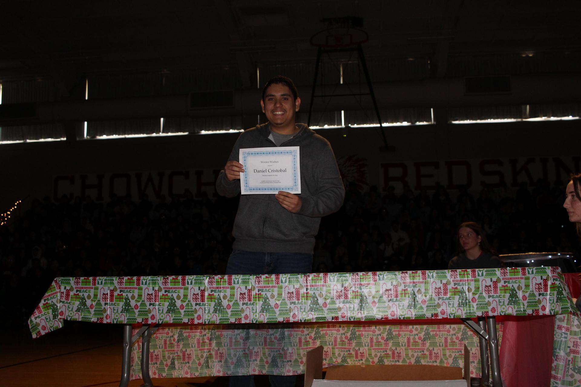 Daniel Cristobal opening his gift