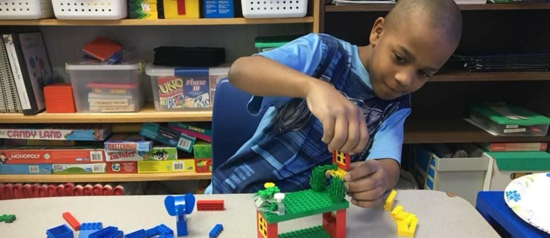 Student creating with Legos