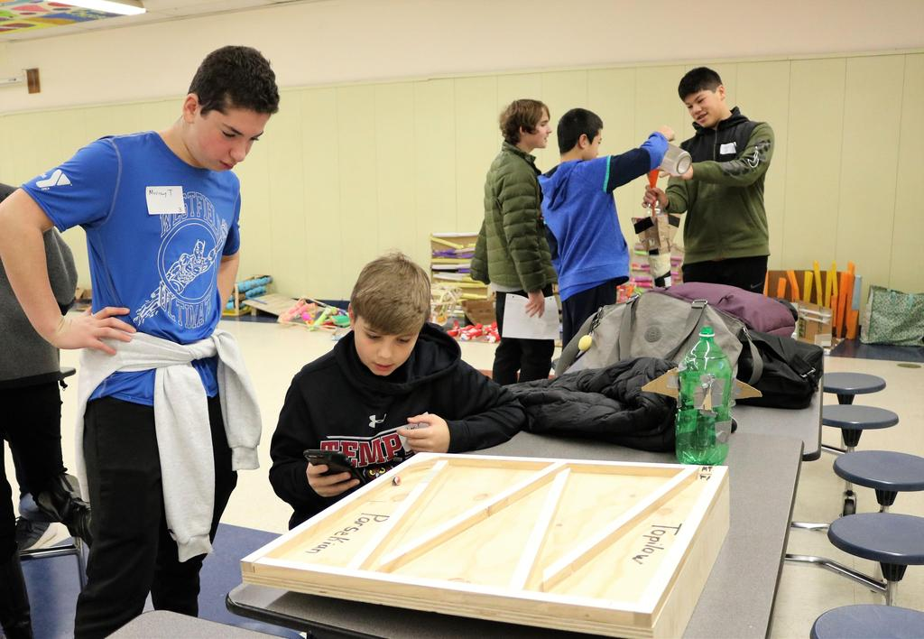 Photo of students testing handmade roller coaster during Science Olympiad at Roosevelt Intermediate School.