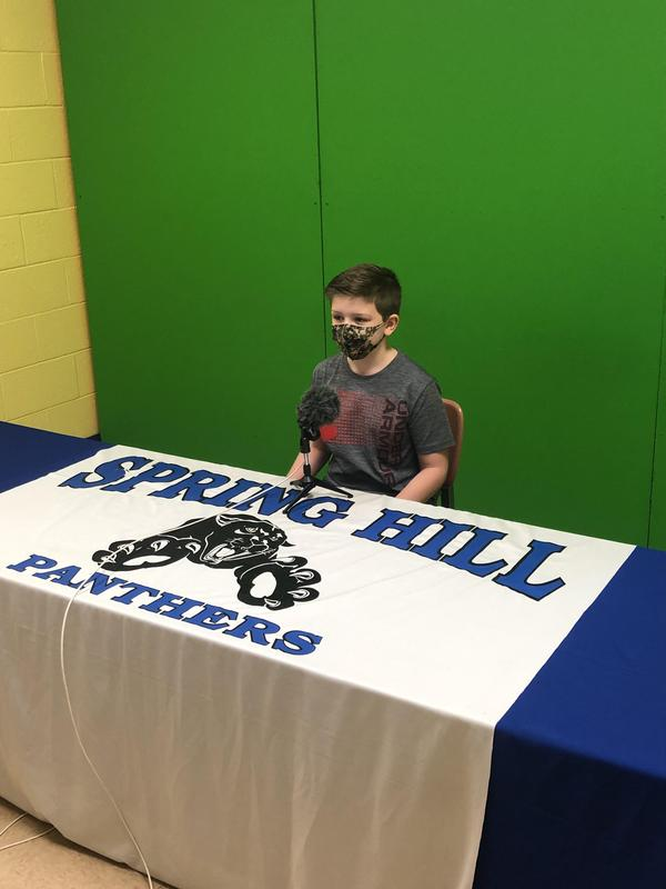 Parker McFaul, third grade student at Spring Hill Intermediate, records the announcement opening.