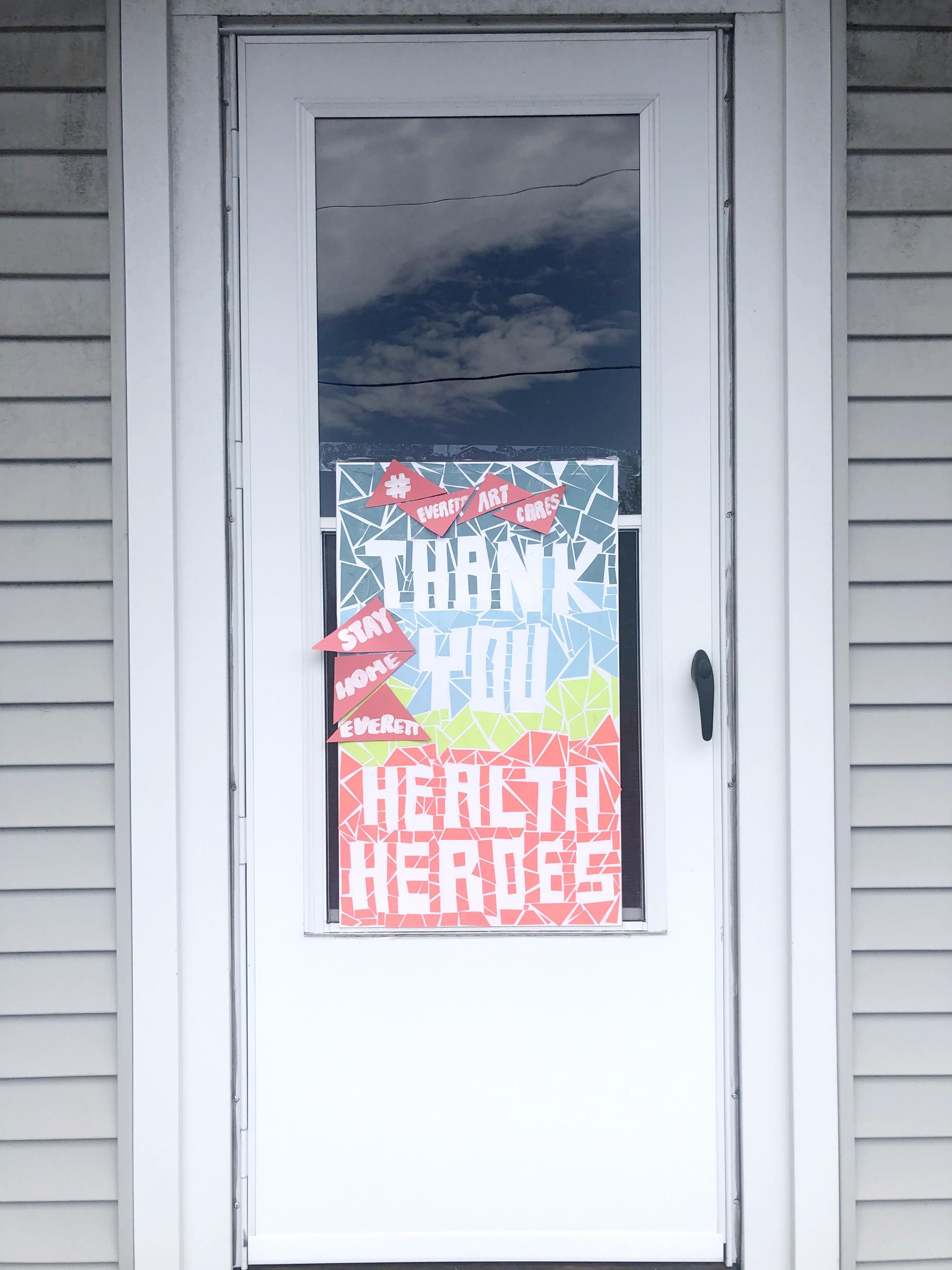 A sign on a door thanking our 'health heroes'
