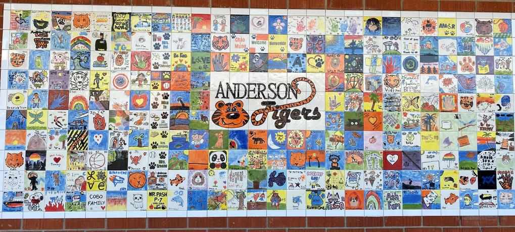 It is a picture of a collage of tiles created by students, families and staff.