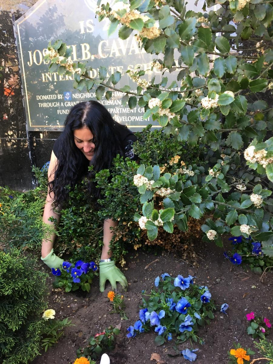 Planting flowers - Photo - Principal Ms. Bender planting flowers