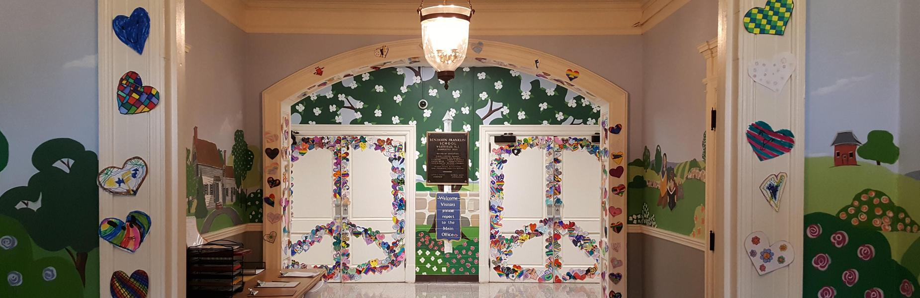 Each 5th grader at Franklin School created a paper heart which then were combined to create giant peace signs on the auditorium doors and elsewhere.