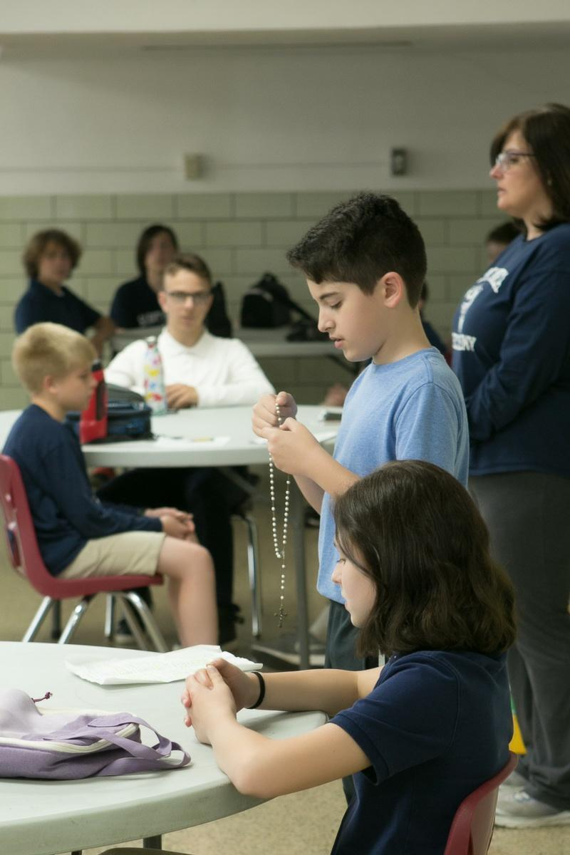 student praying