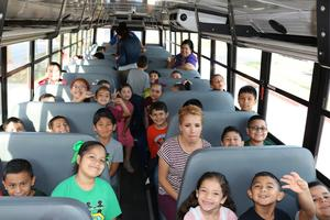 Escobar Rios Elementary students listening to the presenter on the bus.