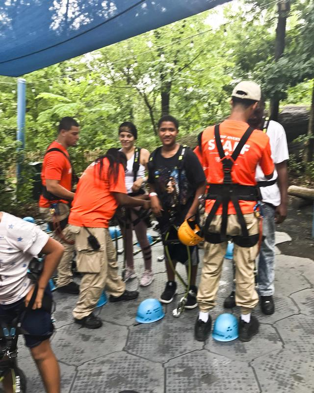 A student and staff member getting ready for the zipline.