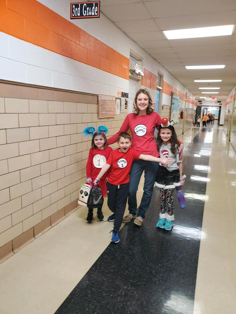 Mrs. Allie Frye and students dressed for Dr. Seuss day