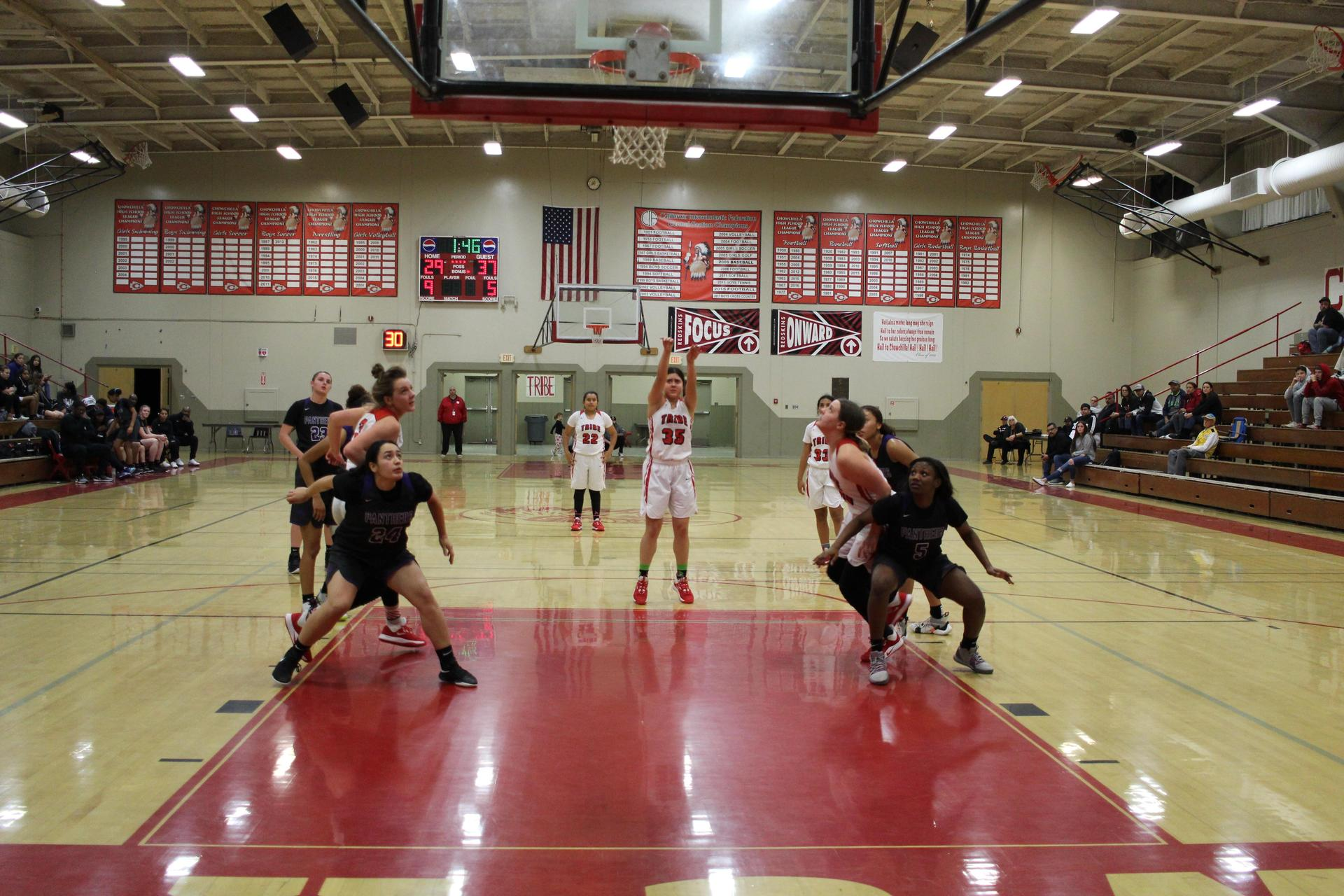 Varsity girls playing basketball