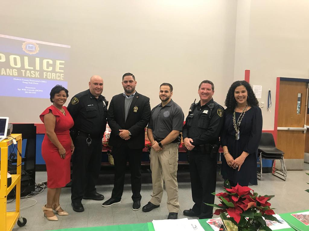 Vanderhorst with UC police officer with and speakers and mrs spencer