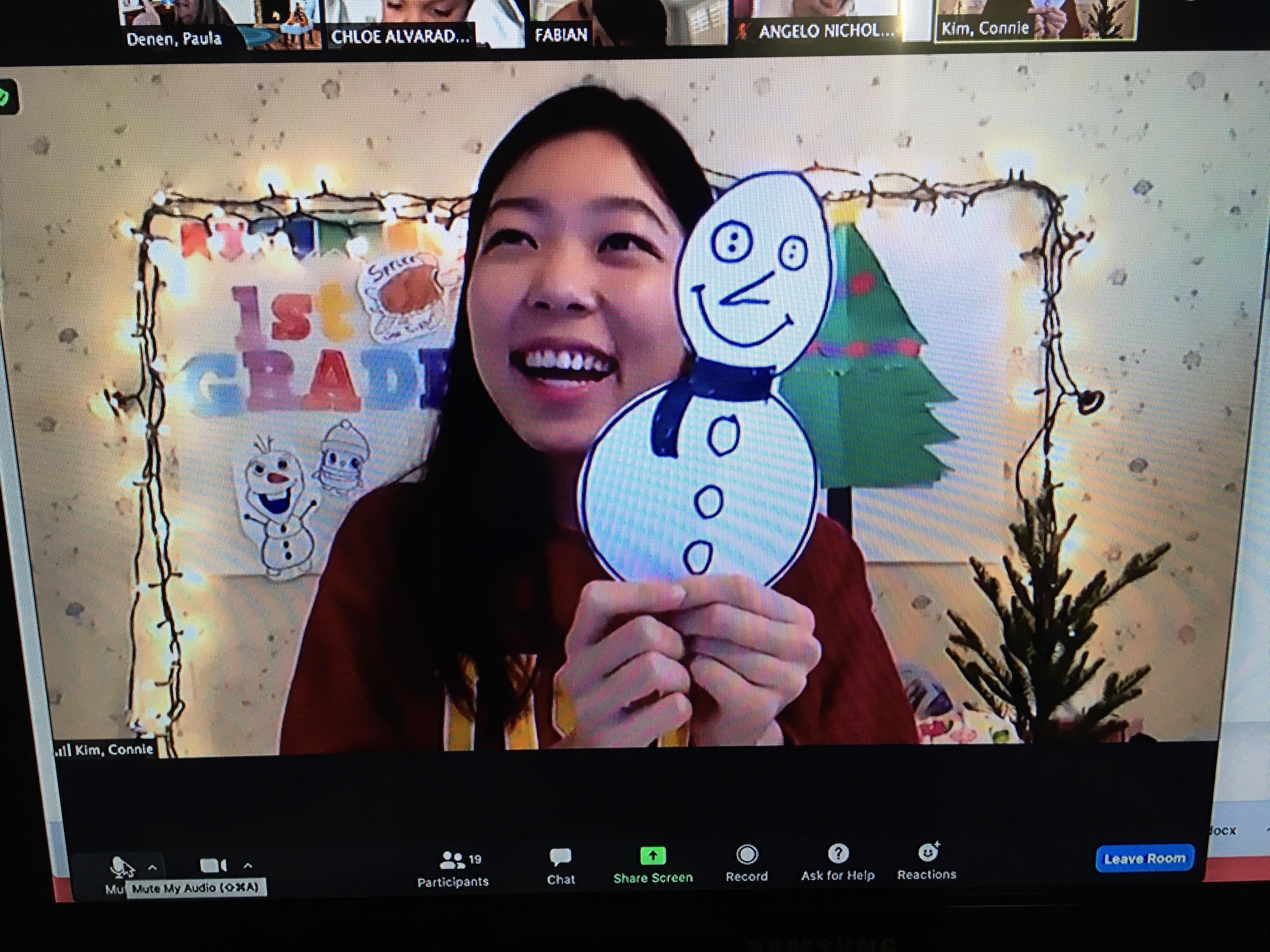 Ms. Kim makes snowman with first grade