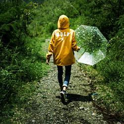 walking in the woods with umbrella