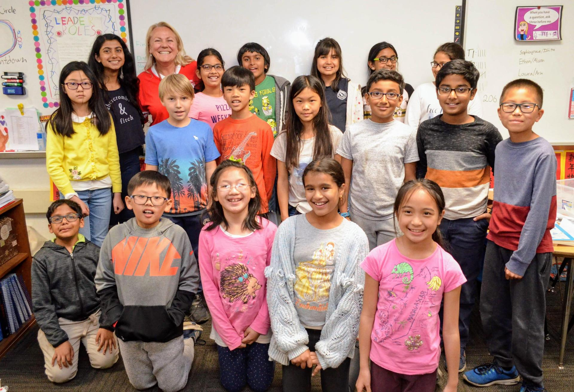 Arcadia High junior Aditee Prabhutendolkar (second from the left standing) with her Baldwin Stocker Elementary Math Circle group.
