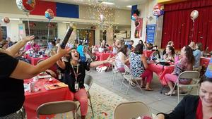 schorlemmer staff members celebrate the school's 10th birthday in the cafeteria with treats and confetti