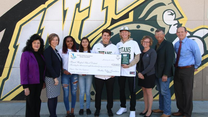 Students and Healthy Valley Foundation Board members with a giant check
