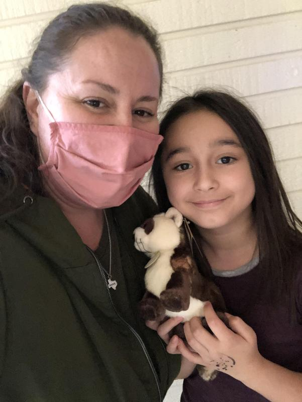 Teacher and student with stuffed animal.