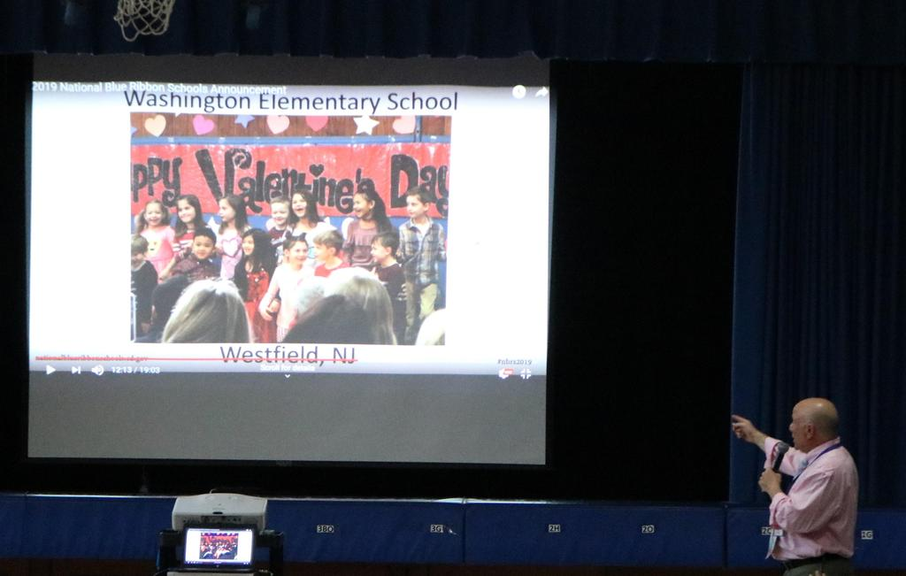 Photo of Washington School principal Dr Andrew Perry showing slideshow announcing Washington as a National Blue Ribbon school.