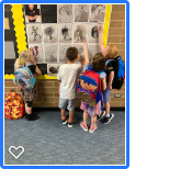 Students admiring his art