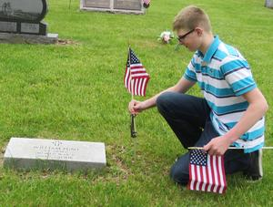TKMS 8th-graders continue the tradition of decorating the graves of veterans with American flags for Memorial Day.