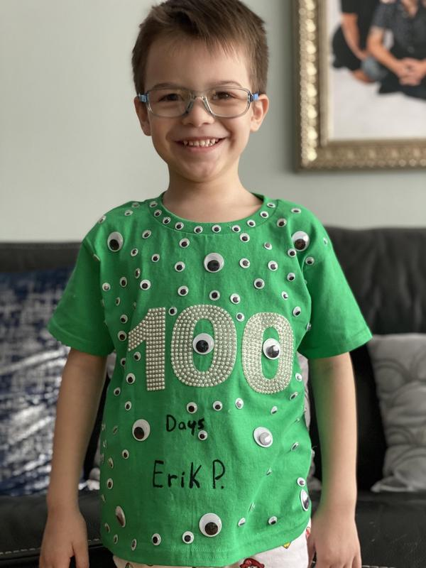 Erik wearing green 100 days shirt
