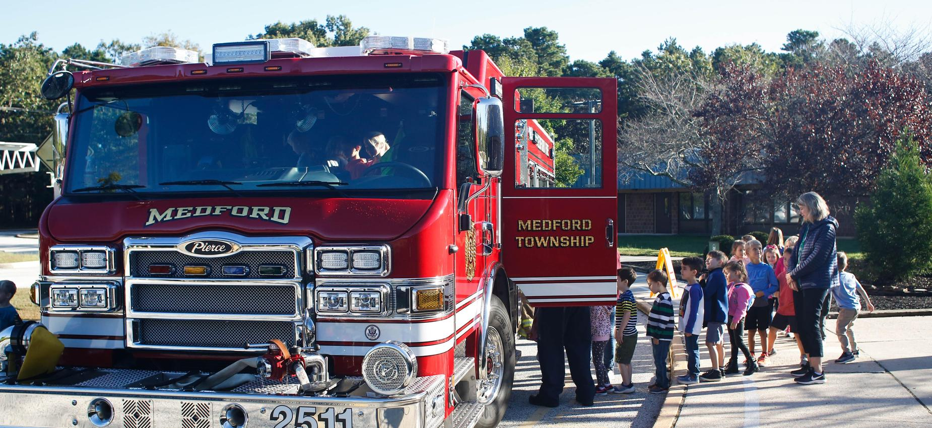 Students looking inside a fire truck