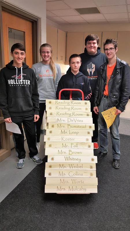 TKHS woods students make and deliver crayon holders to McFall Elementary teachers and staff.