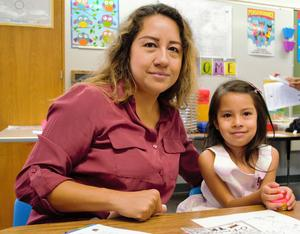 Transitional Kindergarteners from De Anza Elementary settle into their new classrooms alongside their parents on the first day of school for Baldwin Park Unified on Aug. 15.