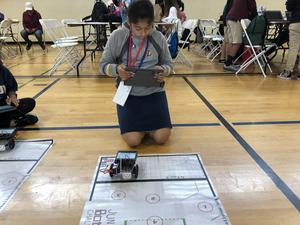 Student commanding robot to move with I Pad.