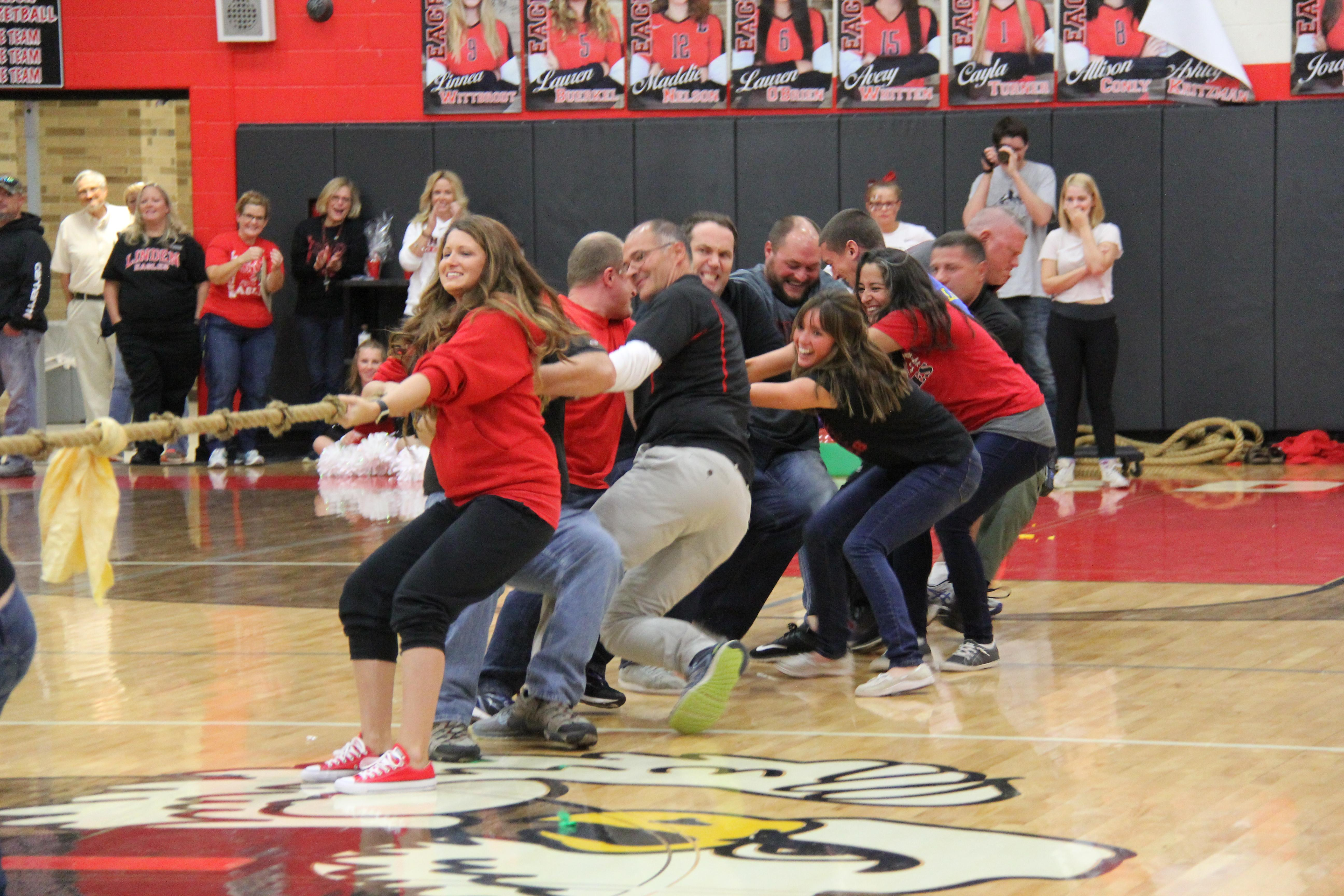 Teachers participating in a tug-of-war contest